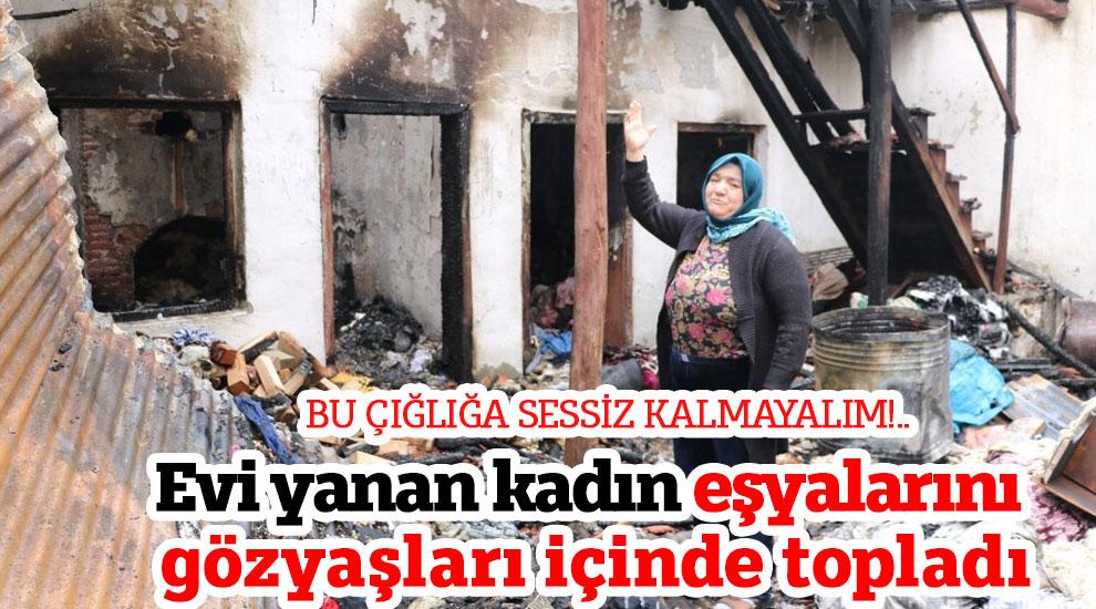 Evi yanan kadın eşyalarını gözyaşları içinde topladı